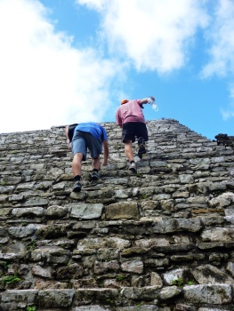 Climbing some steep Maya-steps at Palenque